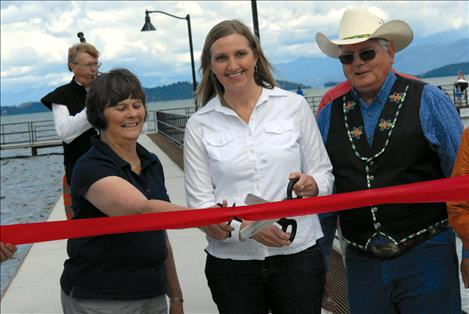 Former Polson Mayor Pat DeVries, Mayor Heather Knutson and CSKT Chair Ron Trahan cut the ribbon.