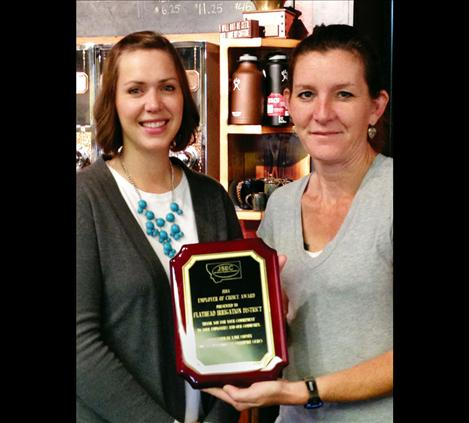 Job Service Employer Committee Chair Whitney Cantlon, left, presents the award to Johanna Clark of the Flathead Irrigation District.