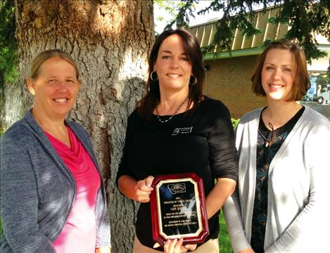 Lake County Job Service Manager Debbie Krantz, left, and Job Service Employer Committee Chair Whitney Cantlon, right, present an Employer of Choice Award to Deanne Richardson of SAFE Harbor.