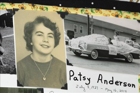 Smiling from her senior picture and riding atop a convertible as homecoming queen, Pat Anderson enjoys life.