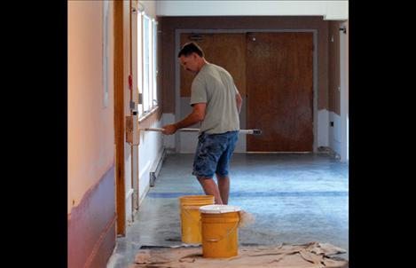 Painters work in the Polson Health and Rehabilitation Center as one step in the renovation of the facility.
