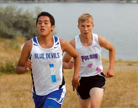 Polson runner Tel Motichka patiently waits to pass another runner.