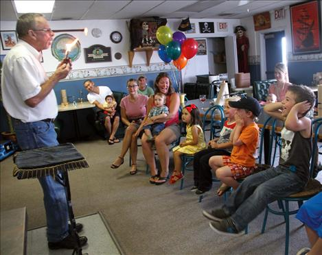 Ken Avison, owner of the Cove Deli and Pizza, performs his 500th birthday party magic show last Friday night.