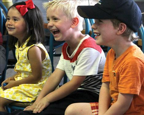 Amaya Shizuku, Finn Goddard and Jaspin Fisher enjoy a magic show Friday, Aug. 8 at the Cove Deli and Pizza.