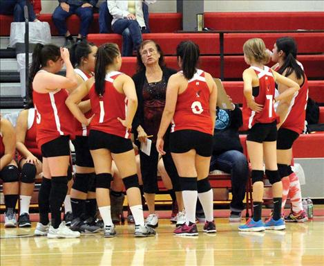 Lady Eagles strategize in between sets.