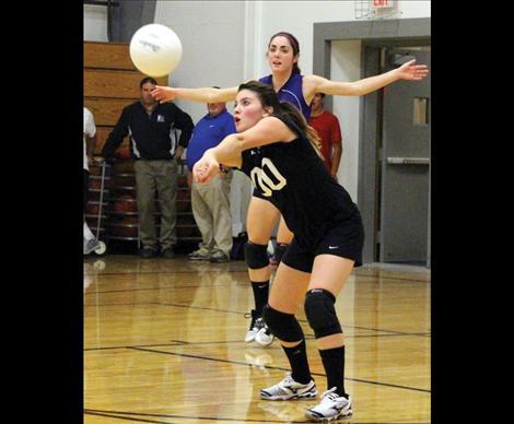 Lady Viking Brooke Doty plants her feet to grab a dig.