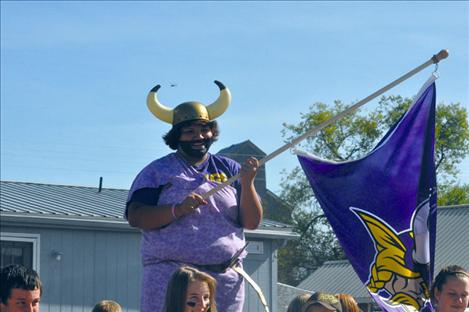 Jessica Dennison shows off her school spirit in the Charlo Homecoming parade.