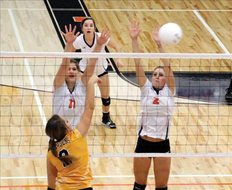 Maiden Sydnee Clairmont slams over a kill while teammate Kendra Starkel provides backup.