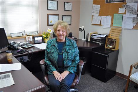 Billie Lee smiles from her old office space that has already been transformed for her suscessor Gypsy Ray.