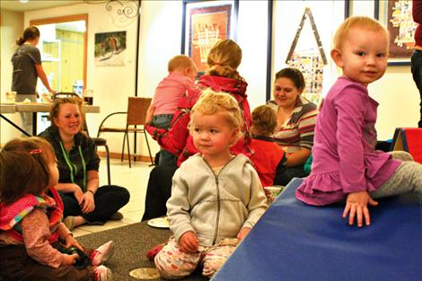 Parents and children getting some needed social time during the playgroup.