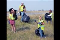 Boys and Girls Club youth clean up highway