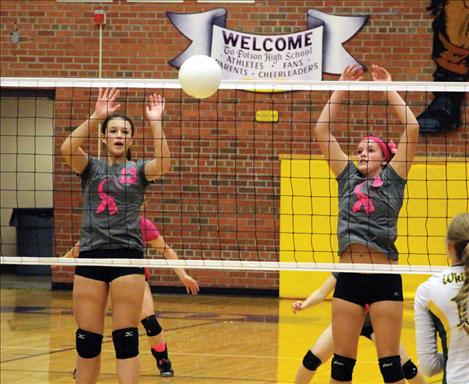 Lady Pirates Haley Fyant and Taylor Brackey guard the net in Thursday's home game.
