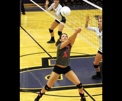 Lady Pirate senior Jaiden Toth pops up after dig, keeping the Lady Pirates alive in a game against Whitefish.