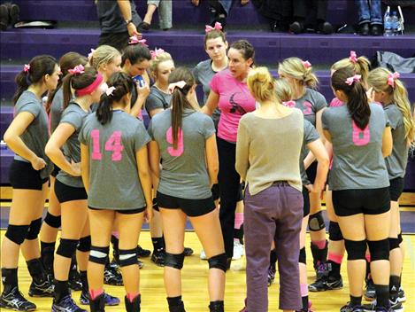 Wearing pink in honor of breast cancer awareness, Coach Jan Toth discusses a plan of attack with the Lady Pirates.