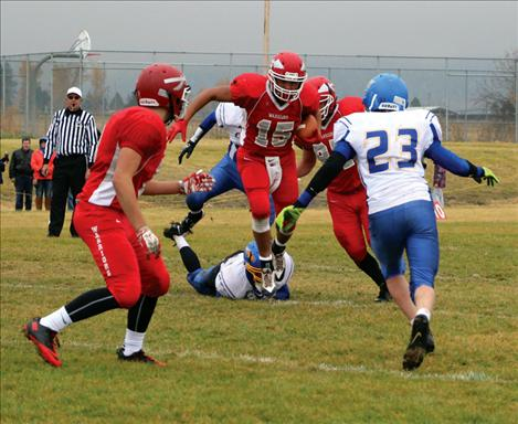 Patrick Big Sam busts through Great Falls' defense in Saturday's playoff game.
