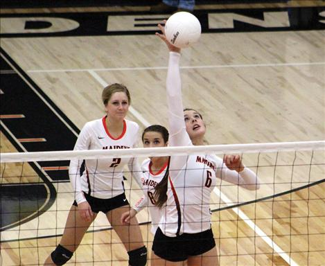 Maiden Kendra Starkel slams the ball over the net in a Divisonal match against Plains.
