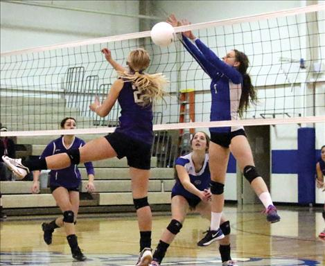 Lady Bulldog Lindsay Johnson blocks a kill from Lady Viking Mikaylan Roylance.