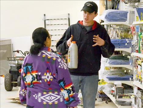 Clay McCready helps a customer find the right item.