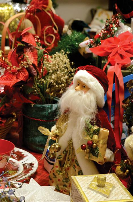 The Folkshop offers a selection of gently-used holiday items at the St. Ignatius thrift store, including a figurine Santa Claus, holiday table decorations, tableware, and more.