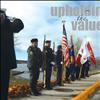 Members of the American Legion, Post 112 in Polson stand at attention along the Armed Forces Memorial Bridge in Polson at 11 a.m. on Nov. 11.