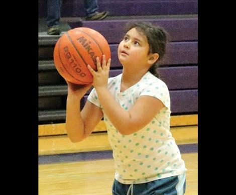 8 year old Dominique He-Crow eyes up her shot at Sunday's Elks Hoop Shoot.