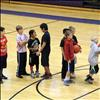 Hoopsters in the 10-11 year old group share freindly conversation while warming up.