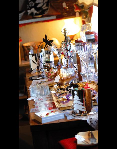 Vintage glassware and other items sparkle in the light.