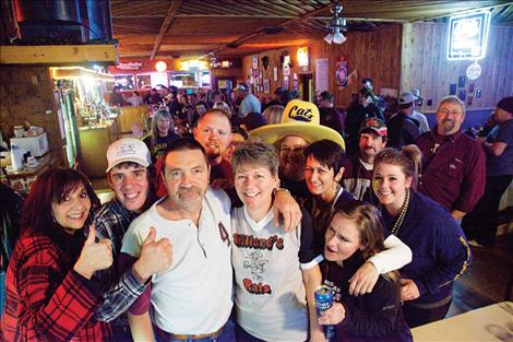 "Members of the ""bar family"" see Willard and Julie Moore, center, off in a going away party."