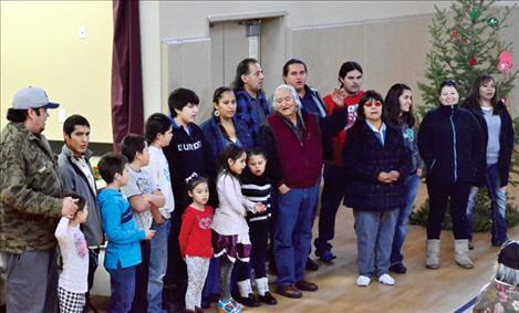 Students and staff from Nkwusm sing Jingle Bells and other songs to honor the elders.