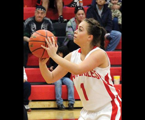 Lady Eagle Casadi Wunderlich prepares to fire a free throw in Saturday's game against Hot Springs. Wunderlich has proved to be a point leader for the Lady Eagles.