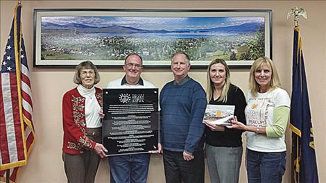 Heart and Soul project members Penny Jarecki, Daniel Smith, and Darlis Smith (right), present Polson City Manager Mark Shrives and Polson City Mayor Heather Knutson (center) with a plaque to the city for its help with the community Heart and Soul project.