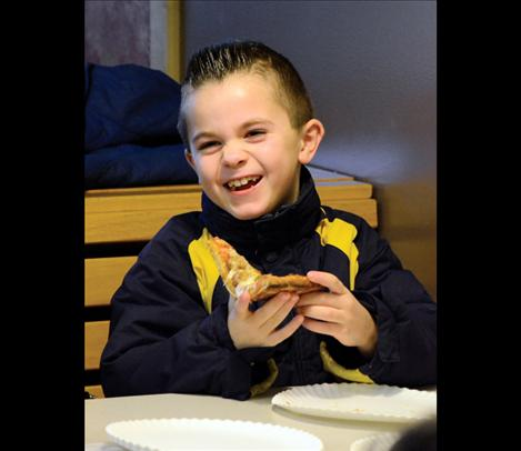 Sawyer Pule, 7, enjoys lunch at Cornerstone Pizza in St. Ignatius.