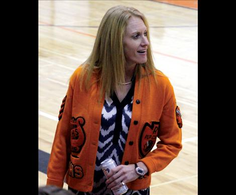 Wearing a sweater from the '70s, Ronan Athletic Director Courtney Fisher organized the throwback game to attract former athletes and students to attend more high school events.