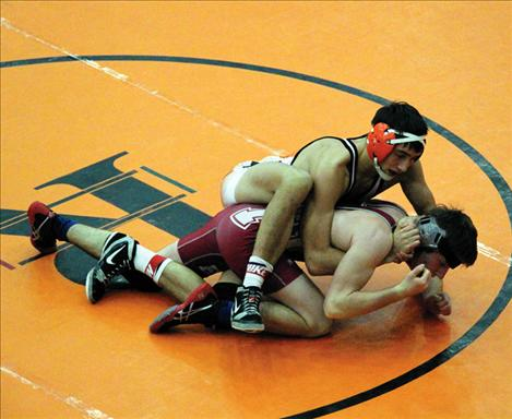 Chief Jared Neiss uses grappling moves to lock a Hamilton-Victor opponent up on the mat. Neiss won six matches at the Western Montana Duals Tournament.