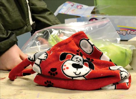 Cozy fleece bags were handmade by 4-H girls for children who, for safety reasons, need to be removed from their homes by protective services.