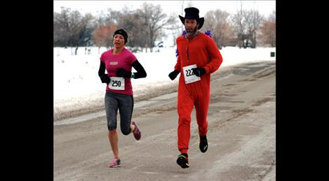 Trisha Drobeck and Matt Seeley pace each other in the chilly morning race to take second and third overall.