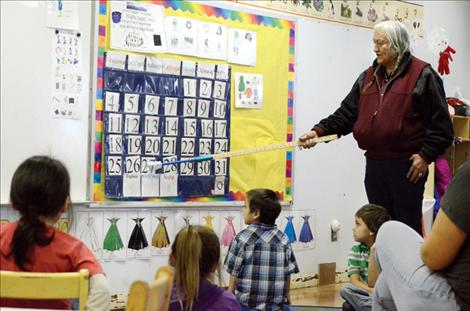 Stipn Smallsalmon helps preschool students learn the days of the week in Salish.