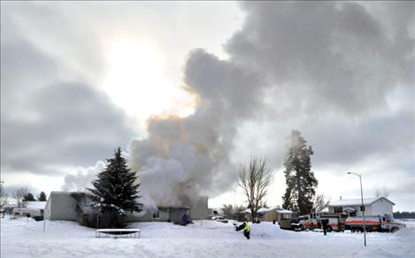 Firefighters fight a blaze Jan. 14 at 34132 Loolee Drive that left two families homeless.
