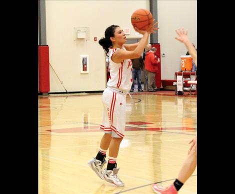Scarlet Becca Whitesell sets up from three-pointer territory.