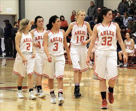 Scarlets Ella Lindburgh, Morgan Malatare, Becca Whitesell, Carly Hergett and Bryndle Goyins strut onto the court — a strut well deserved as the Scarlets have dominated their conference all the way to first place in the tough District 14-C.