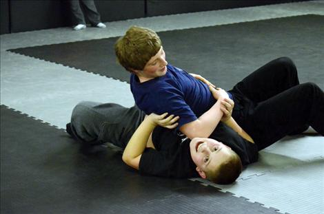 Karen Peterson photo Christian Smith, 12, and Gabe Moxness, 13, practice their skills on the new mats.
