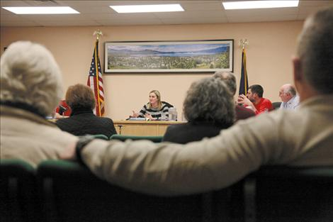 Nicole Tavenner/Valley Journal Polson Mayor Heather Knutson listens intently as Melissa Hornbein, staff attorney for the Reserved Water Rights Compact Commission presents information on how the water comact affects municipalities.
