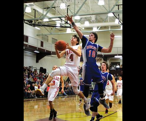 Warrior Phillip Malatare drives to the basket during District play, and scored double digits in two games last weekend at Divisionals.
