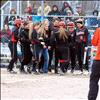 Maiden Amanda Morency is met at the plate by her teammates after launching a homerun over the fence in the Maidens opening game against MAC.