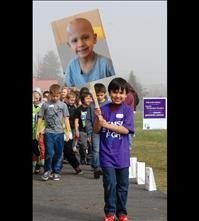 Young cancer survivor leads Recess Relay at Linderman School