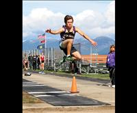 Polson hosts Triangular track and field meet despite snowflakes