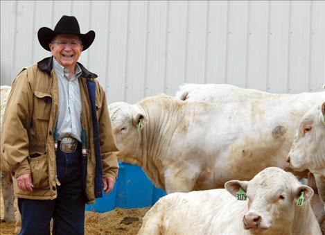 Ranch owner Buddy Westphal  prepares to begin the annual sale of his Charolais bulls.