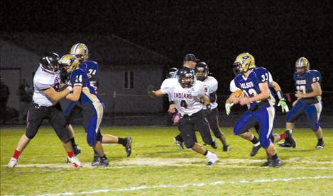 Polson running back Josiah Edington avoids a Browning defender Friday night.