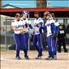 Fist bumps between innings shows Lady Bulldog support for one another.
