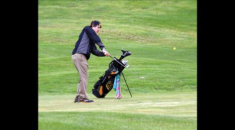 Lane Garcia chips off of the fairway at Tuesday's  home-hosted tournament.
